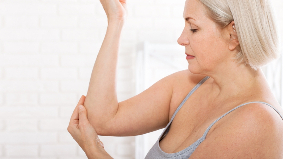 Woman examining her arm