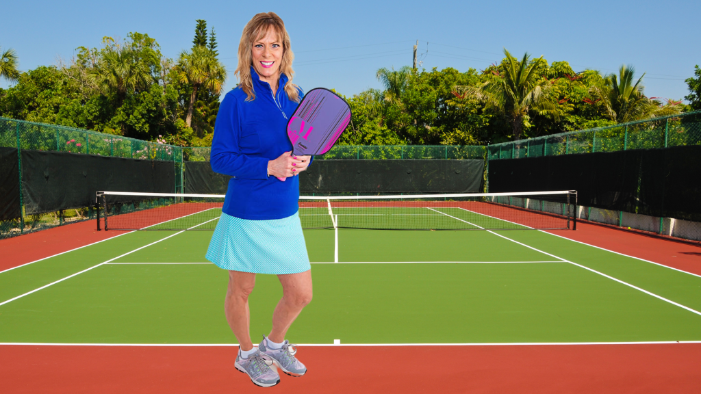 Mary-Pat Marzoli with pickleball paddle