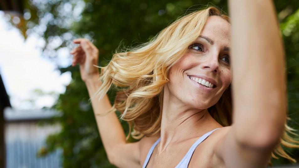 happy woman dancing outdoors