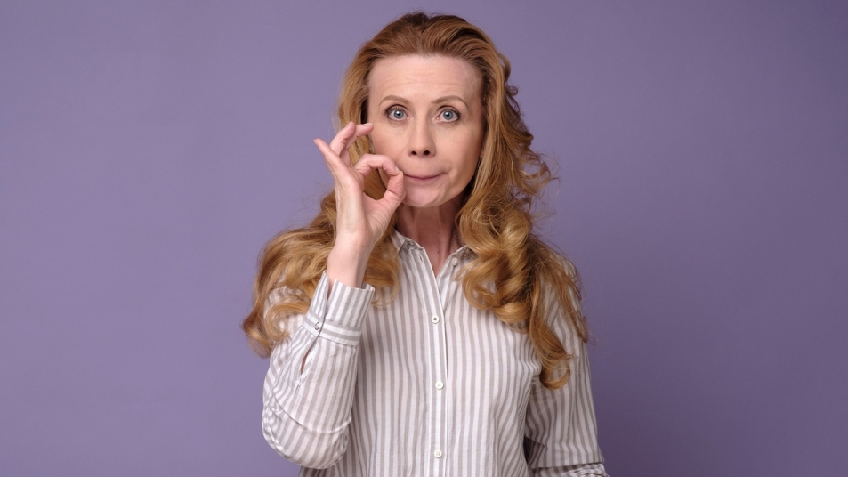 woman making a zip-your-lip gesture