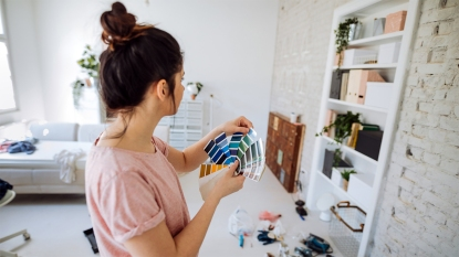Woman picking out paint colors
