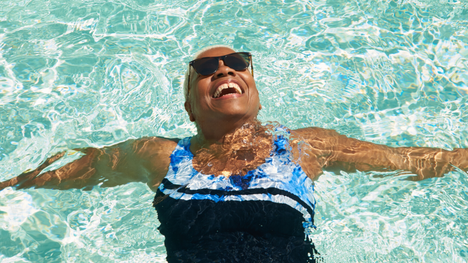 relaxed woman floating in a pool